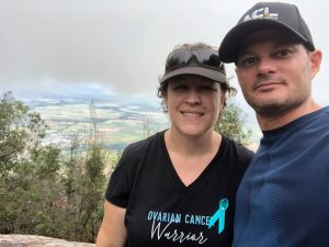 Annette and her partner Alan hiking Walsh's Pyramid to celebrate overcoming ovarian cancer